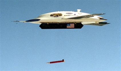 April  19, 2004 : X-45A (UCAV) Combat Drone : An X-45 aircraft releases an inert GPS-guided bomb Sunday at the Naval Air Warfare Center Weapons Division range in China Lake, California.